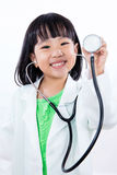 Happy Asian Chinese Little Girl Holding Stethoscope. In  white background Stock Image