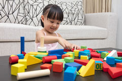Happy Asian Chinese little girl playing building blocks at home Stock Images
