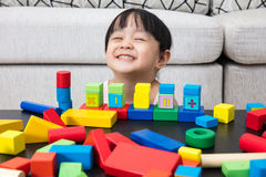 Happy Asian Chinese little girl playing building blocks at home Royalty Free Stock Photography
