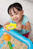 Happy Asian Chinese little girl playing kinetic sand at home Royalty Free Stock Photography
