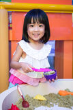 Happy Asian Chinese Little Girl Playing Kinetic Sand Indoor Royalty Free Stock Photo