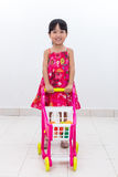 Happy Asian Chinese little girl pushing toy trolley Stock Images