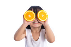 Free Happy Asian Chinese Little Girl Using Orange As Glasses Royalty Free Stock Image - 81657836