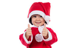 Happy Asian Chinese little santa claus girl with thumbs up. In isolated white background Royalty Free Stock Images