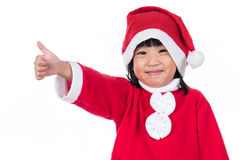Happy Asian Chinese little santa claus girl with thumbs up Stock Photography