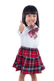 Happy Asian Chinese little student girl showing thumbs up Royalty Free Stock Image