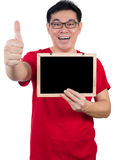 Happy Asian Chinese man  holding blackboard with thumbs up Stock Photography