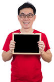 Happy Asian Chinese man wearing red shirt holding blackboard Stock Photography