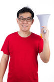 Happy Asian Chinese man wearing red shirt holding loudspeaker Royalty Free Stock Photo