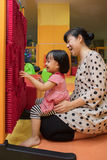 Happy Asian Chinese mom and daughter playing pin board Royalty Free Stock Photos