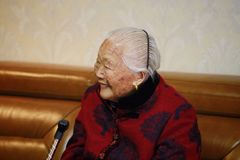 Happy Asian Chinese old woman 90s. Happy Asian Chinese old woman, 93 years old, up to 90s , silvery hair, golden earing on her ear Stock Photography