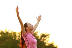 happy Asian Chinese woman embrace nature and sun stock image