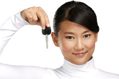 Happy asian chinese woman giving key car Royalty Free Stock Images