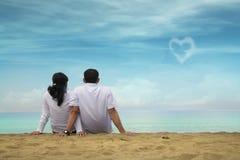 Happy asian couple at beach royalty free stock photos