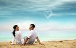 Happy asian couple at beach Stock Photos