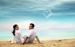 Happy asian couple at beach. Smiling Stock Photos
