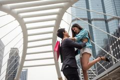 Happy Asian couple celebrate Valentine in town. Happy handsome and beautiful Asian couple enjoy Valentine day and love aniversary by shopping in modern city with Stock Photo