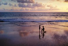 Happy Asian couple dating at the beach during travel honeymoon trip on holidays vacation outdoors. Ocean or nature sea at sunset,. Phuket, Thailand stock photo
