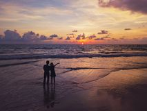 Happy Asian couple dating at the beach during travel honeymoon trip on holidays vacation outdoors. Ocean or nature sea at sunset,. Phuket, Thailand royalty free stock images