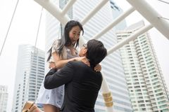Asian couple enjoy Valentine day in town. Happy Asian couple enjoy Valentine day and love anniversary in modern city with building architecture background with Stock Photos