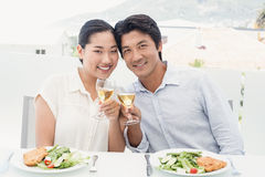 Happy asian couple having meal together Royalty Free Stock Photography