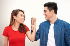 Happy Asian couple holding hand over white background royalty free stock photo