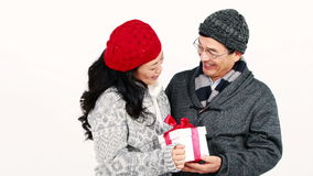 Happy Asian couple holding a present stock video footage