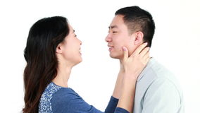 Happy Asian couple kissing and smiling. On white screen stock footage