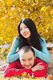 Happy asian couple in love in autumn Royalty Free Stock Photos