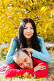 Happy asian couple in love in autumn Stock Photos