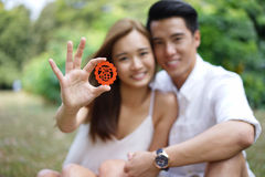 Happy asian couple in love holding symbol Stock Photography