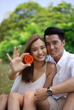 Happy asian couple in love holding symbol Stock Photos