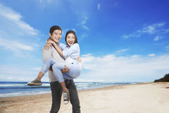 Happy asian couple smiling on the beach Royalty Free Stock Photo
