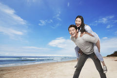Happy asian couple smiling on the beach Stock Images