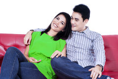 Happy asian couple on sofa Royalty Free Stock Photos