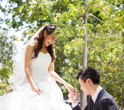 Happy asian couple in wedding dress in a green park Stock Image