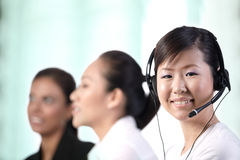 Happy Asian customer service woman Stock Image