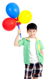 Happy asian cute boy with colorful balloons Royalty Free Stock Photo