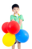 Happy asian cute boy with colorful balloons Royalty Free Stock Photos