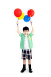 Happy asian cute boy with colorful balloons Royalty Free Stock Photography