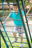 Happy asian cute boy playing on playground Royalty Free Stock Images