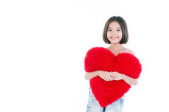 Happy Asian cute girl holding heart royalty free stock images