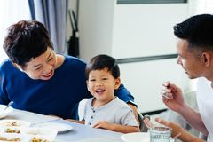 Happy Asian extended family having dinner at home full of laught. Er and happiness Royalty Free Stock Photo