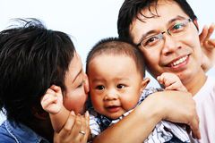 Happy Asian Family. Laughing and enjoying their time royalty free stock image