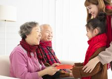 Asian family celebrate Chinese new year at home stock photos