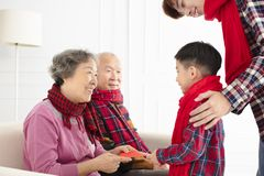 Happy family celebrate Chinese new year at home stock photos