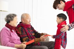 Happy family celebrate Chinese new year at home royalty free stock photo