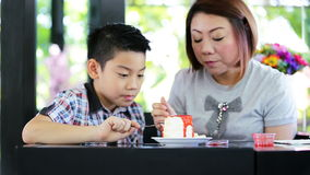 Happy asian family eating cake together with happy face