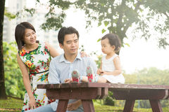 Happy Asian Family enjoying their time in the park Royalty Free Stock Images