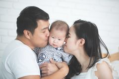 Happy asian family father mother with daughter kissing with smil stock photography